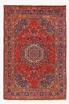 An old Meshad carpet ca 294 x 194 cm.