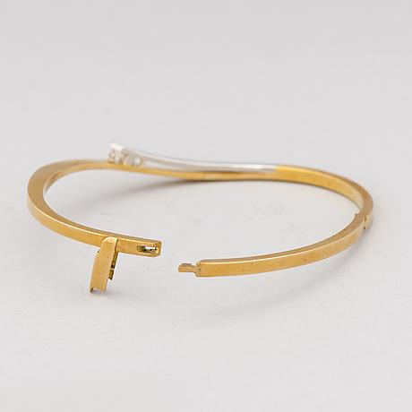 A bracelet, brilliant cut diamonds, 18k gold and white gold