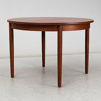 a teak dining table from the second half of the 20th century.