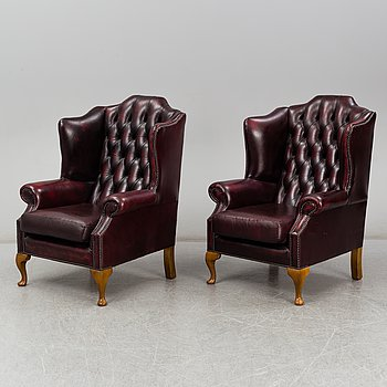 A pair of Chesterfield armchairs, late 20th century.