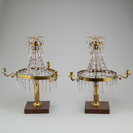 A pair of late gustavian style three-light candelabra.