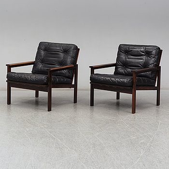 A pair of 'Capella' rosewood easy chairs by Illum Wikkelsø.