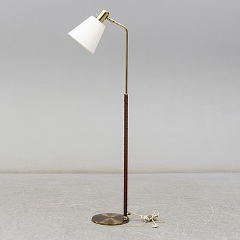 a brass and leather floor lamp from the second half of the 20th century.