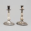 Cg hallberg, a pair of silver candle holders, 1948