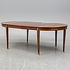 An early 20th century gustavian style dining table. two leaves included