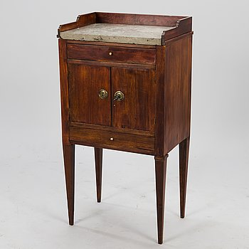 An early 19th Century bedside table in late Gustavian style.