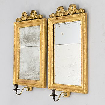 A pair of mirrored wall sconces from the latter half of the 20th century.