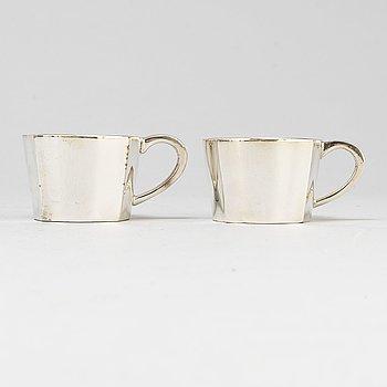 28 Sigvard Bernadotte silver plate cups.