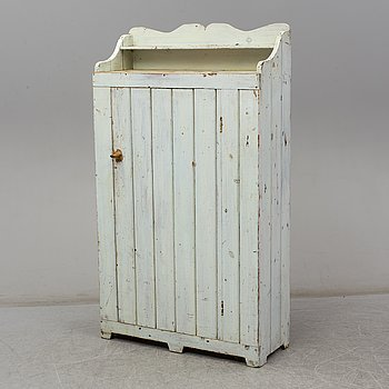 a painted wooden cabinet from the 19th century.