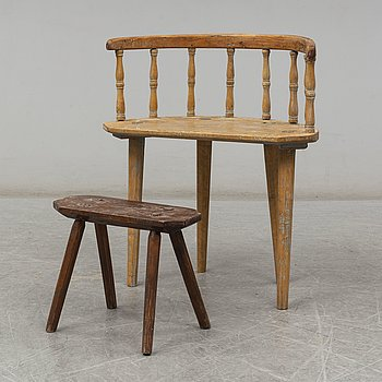 a swedish wooden chair with a stool from the 19th century.