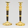 A pair of french empire candlesticks, early 19th century