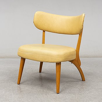 an armchair from the mid 20th century.