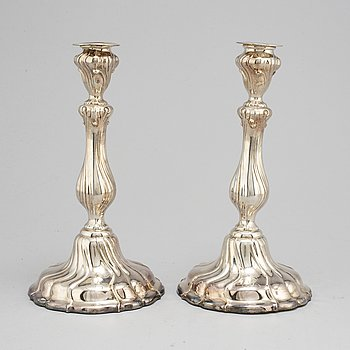 a pair of rococo-style silver candlesticks, 20th century.