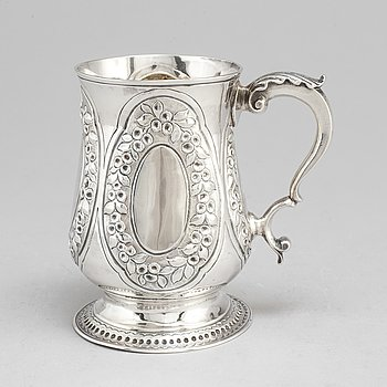 A silver tankard by Henry Brind, London 1747.