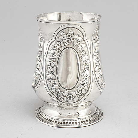 A silver tankard by henry brind, london 1747.