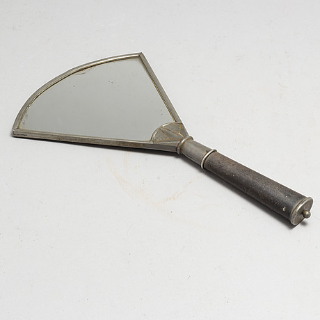 Nils fougstedt, a pewter hand mirror model 619 from firma svenskt tenn, 1920's/30's.