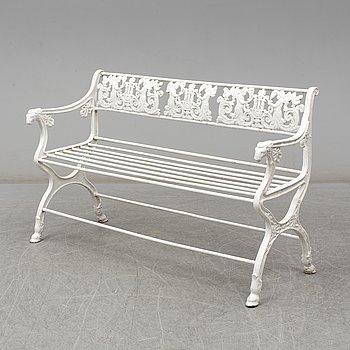 A cast iron garden sofa, empirestyle, circa 1900.