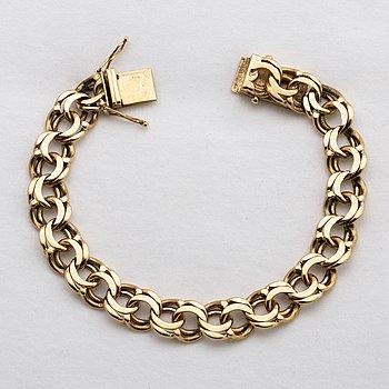 An 18K gold bracelet, weight ca 36,4 gr.