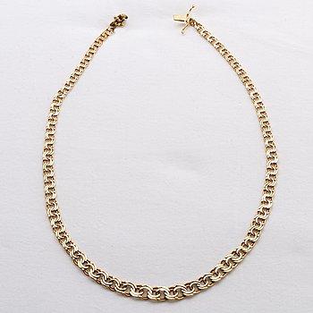 An 18K gold neck chain weight ca 22,9 gr.
