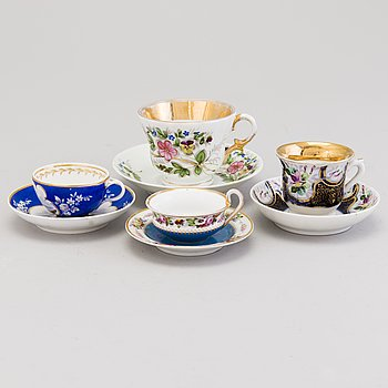 Four Russian 19th Century porcelain cups with saucers, by Popov and Kuznetsov.