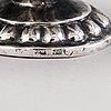 Four russian 19th century silver salt cellars and four finnish 1920s parcel gilt salt spoons