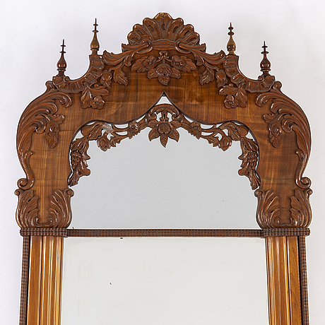 A mahogany veneered mirror, mid 19th century