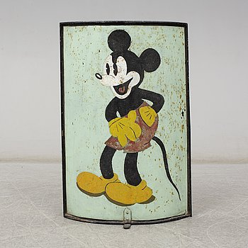A metal fire screen with a painted image of Mickey Mouse, mid 20th Century.