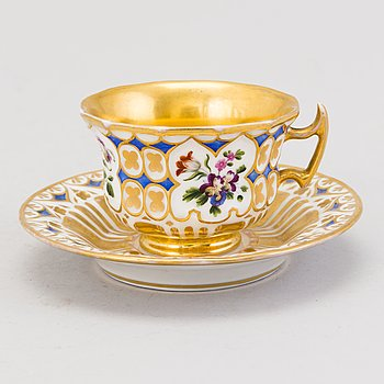 A Popov porcelain cup with saucer, Russia mid-19th Century.