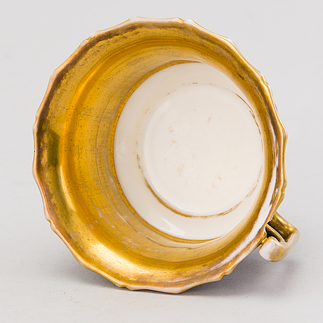 A popov porcelain cup with saucer, russia mid 19th century