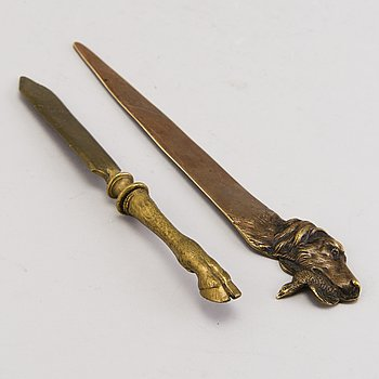 TWO PAPERKNIVES, bronze, possibly Russian.