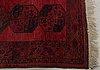 A semaintique afghan carpet ca 320 x 229 cm