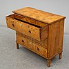 An early 19th century chest of drawers