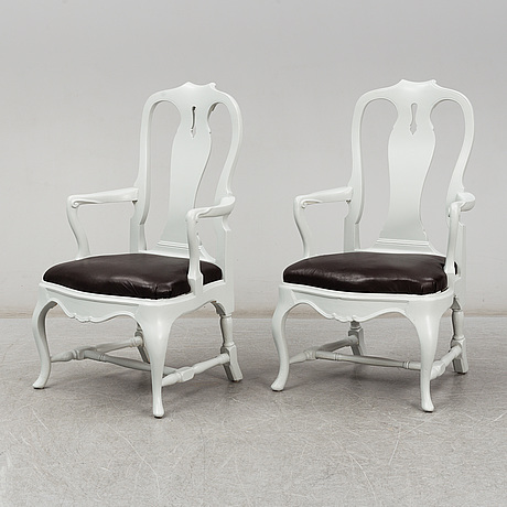 A pair of painted rococo style armchairs, first half of the 20th century