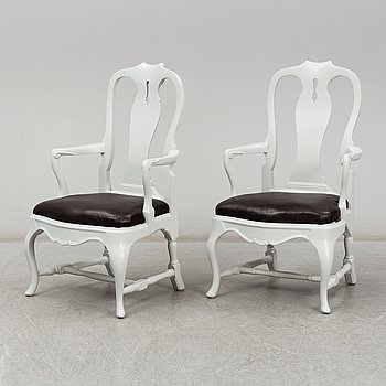 A pair of painted Rococo style armchairs, first half of the 20th Century.