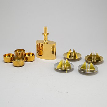 Pierre Forsell 4 candle holders, bottle and four cups, brass and aluminium. Skultuna.
