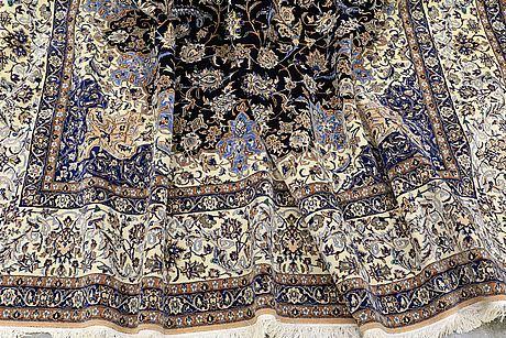 A carpet, nain part silk, 380 x 260 cm