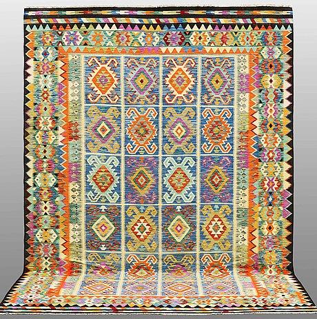 A kilim carpet, ca 345 x 245 cm