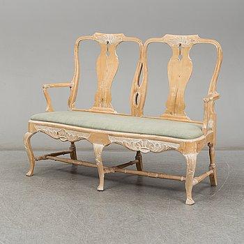 A mid 20th century Rococo style sofa.