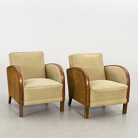 A pair of first half of the 20th century lounge chairs