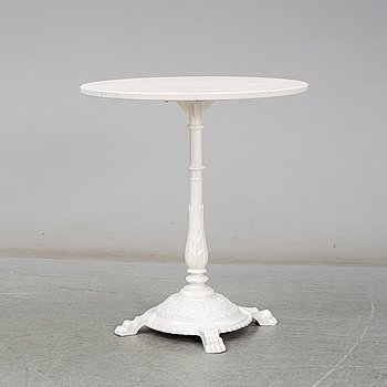 A cast iron and marble café table from Byarum.