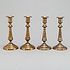 Four (2+2) brass candle holders, including skultuna.