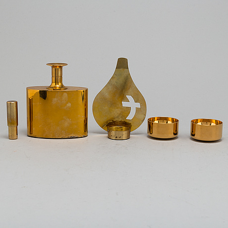 Pierre forssell, six gilt brass cups and a bottle, as well as candle holder, from skultuna bruk