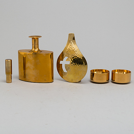 Pierre forssell, six gilt brass cups and a bottle, as well as candle holder, from skultuna bruk.