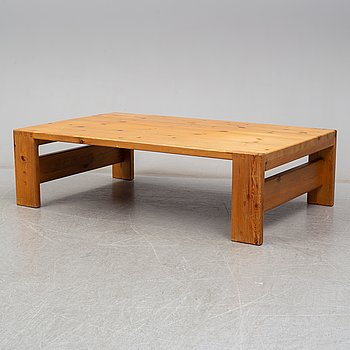 A 1960s pine coffee table.