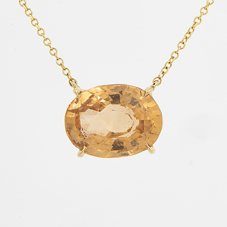 An oval faceted yellow garnet necklace.