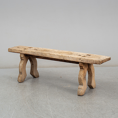 A 19th century folk art bench.