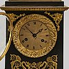 An empire style late 19th century mantel clock