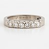 An 18k white gold ring set with round brilliant cut diamonds