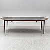 A 1960's rosewood veneered dining table.