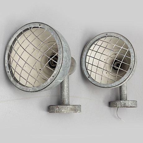 A pair of industrial wall lamps.